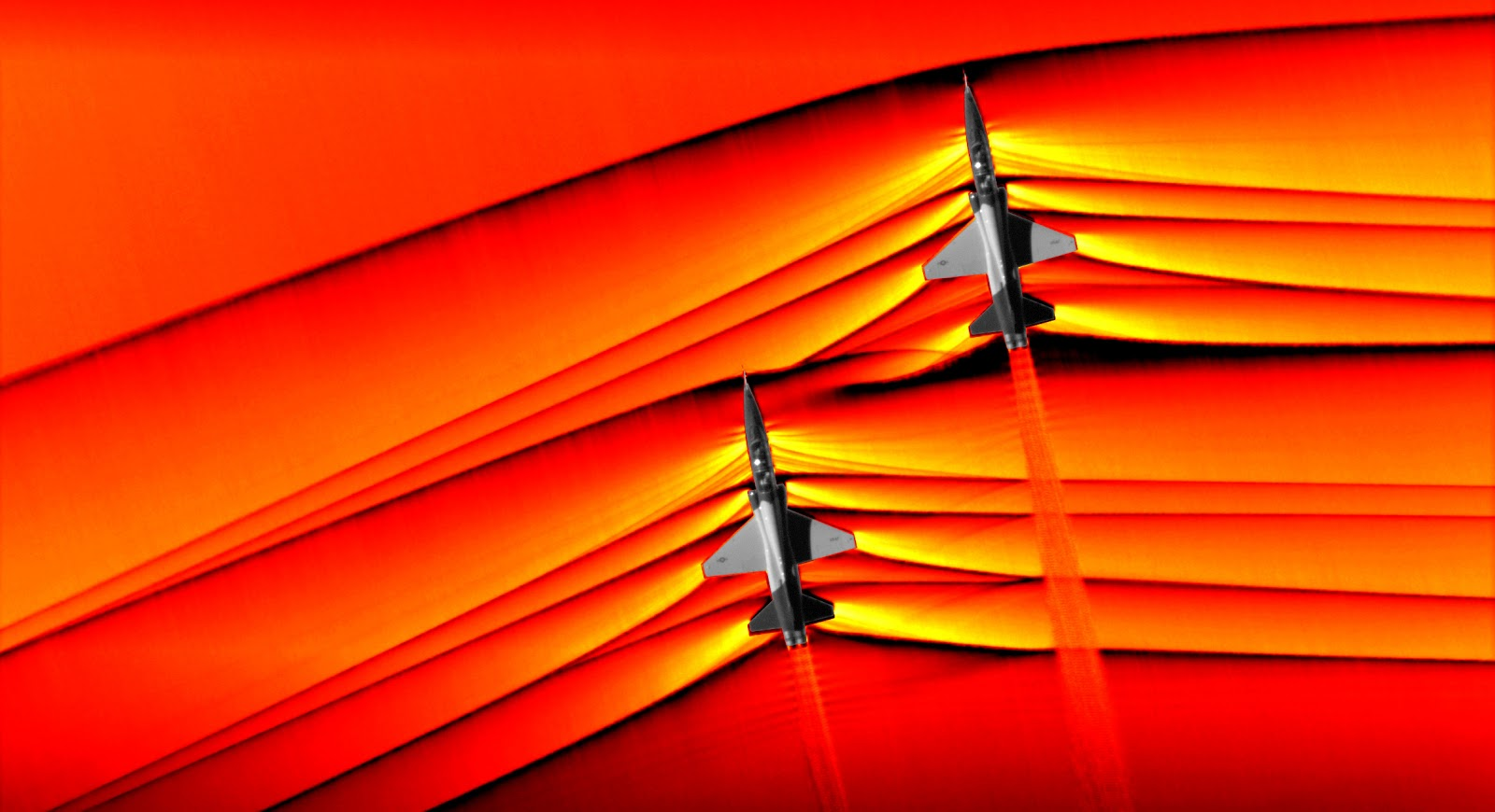 Figure 2: Schlieren Photography Revealing The Interaction Of Shockwaves Produced By Two T 38 Flying In Formation At A Supersonic Speed [4]